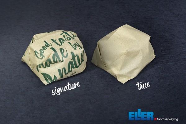 Einwickelpapier aus Gras Papier verpackt einen Hamburger umweltfreundlich.