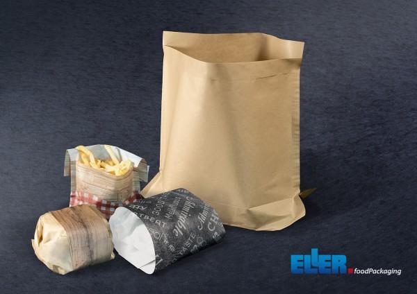 Braune Papiertüte mit Hamburger und Pommes