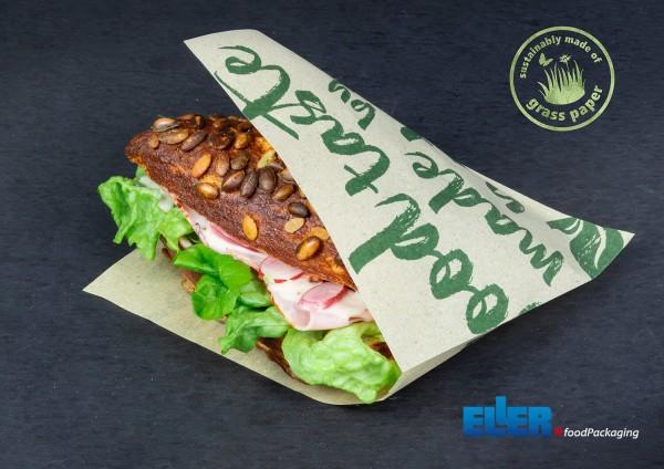 Spitztüte aus Graspapier mit eingelegtem Sandwich.